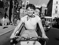 220px-Audrey_Hepburn_and_Gregory_Peck_on_Vespa_in_Roman_Holiday_trailer.jpg
